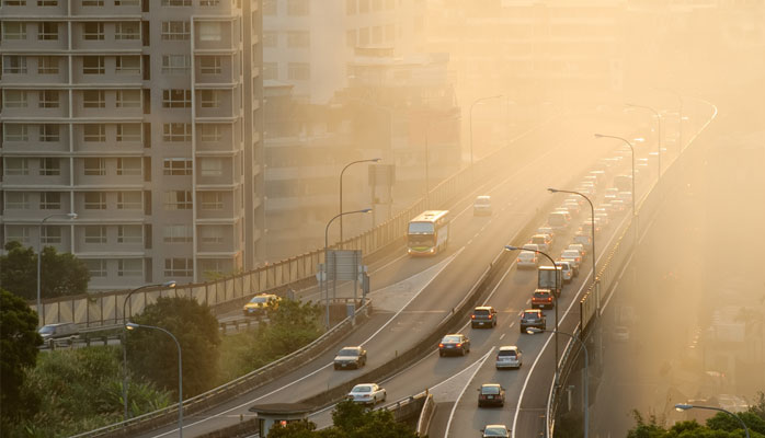 Air pollution in the city caused by industrial smog, emission of the vehicles